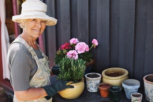 Mature woman potting plants