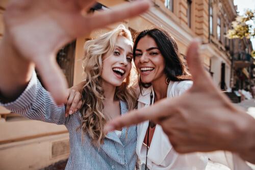 Women friends taking selfie together
