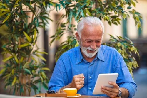man reading book tablet